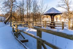 Snowy Photo of the Park on a Sunny Winter day - Wooden Footpath in the Middle of it, Concept of the Harmony and Travel. In the Countryside stock photography