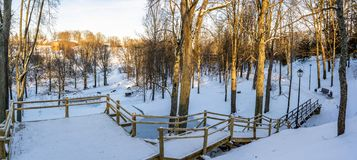 Snowy Photo of the Park on a Sunny Winter day - Wooden Footpath in the Middle of it, Concept of the Harmony and Travel. In the Countryside royalty free stock photos