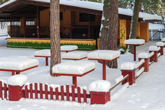 Snowy picnic table at abandoned cafe in forest of Riga, Latvia Stock Photos