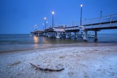 Snowy pier at Baltic Sea in Gdansk. Baltic Sea pier in Gdansk at dusk, Poland Royalty Free Stock Images