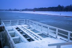 Snowy pier at Baltic Sea in Gdansk. Poland Royalty Free Stock Image