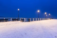 Snowy pier at Baltic Sea in Gdansk. Poland Stock Photo