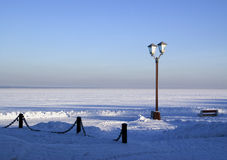 Snowy pier of Onego lake in Russia Royalty Free Stock Photo