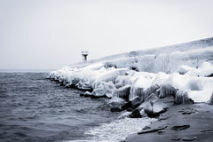 Snowy pier in winter with tower Royalty Free Stock Image