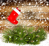 Snowy pine branch with Red christmas boot Stock Image