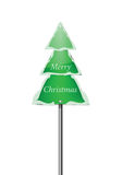 Snowy Pine Tree Road Sign with Merry Christmas stock photo