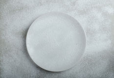 Snowy plate background Stock Photo