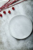 Snowy plate, Christmas decorations. Winter mood, clean background Royalty Free Stock Image