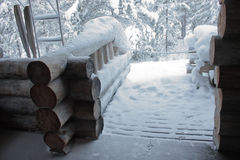 Snowy porch of wooden house Royalty Free Stock Image