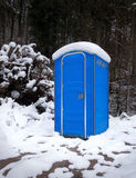 Snowy portable toilet in the forest Stock Photos