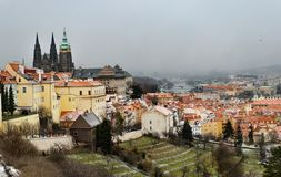 Snowy Prague City with gothic Castle from Hill Petrin royalty free stock photo