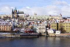 Snowy Prague City with gothic Castle  in the sunny Day, Czech Republic Royalty Free Stock Image