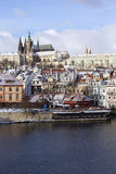 Snowy Prague City with gothic Castle  in the sunny Day, Czech Republic Stock Photos