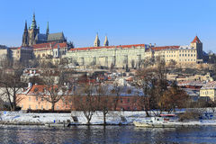 Snowy Prague gothic Castle abova River Vltava, Czech Republic Stock Photography
