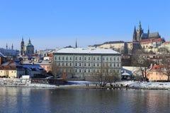 Snowy Prague gothic Castle abova River Vltava, Czech Republic Stock Image