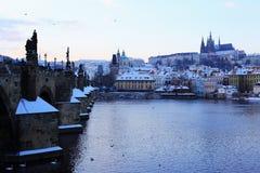 Snowy Prague gothic Castle abova River Vltava, Czech Republic Stock Photo