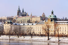 Snowy Prague gothic Castle above River Vltava Stock Images