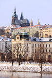 Snowy Prague gothic Castle above River Vltava Stock Image