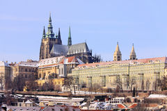 Snowy Prague gothic Castle above River Vltava Stock Photos