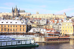 Snowy Prague gothic Castle above River Vltava in the sunny Day Stock Images