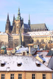 Snowy Prague gothic Castle above River Vltava in the sunny Day Royalty Free Stock Image