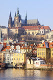 Snowy Prague gothic Castle above River Vltava in the sunny Day Stock Photo