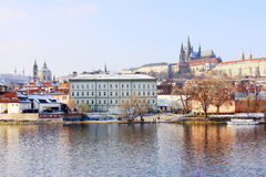 Snowy Prague gothic Castle above River Vltava in the sunny Day Royalty Free Stock Photography