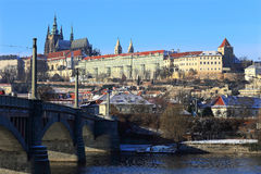 Snowy Prague gothic Castle above River Vltava in the sunny Day, Czech Republic Royalty Free Stock Images