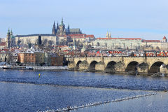 Snowy Prague gothic Castle with Charles Bridge, Czech Republic Stock Photos