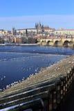 Snowy Prague gothic Castle with Charles Bridge, Czech Republic Stock Images
