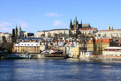Snowy Prague gothic Castle on the River Vltava Stock Photography
