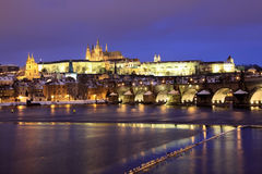 Snowy Prague gothic Castle on the River Vltava wit Royalty Free Stock Image