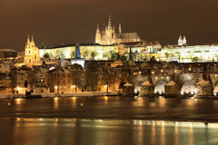 Snowy Prague gothic Castle on the River Vltava wit Stock Photography