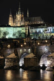 Snowy Prague gothic Castle on the River Vltava wit royalty free stock photography