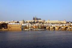 Snowy Prague Gothic Castle With Charles Bridge Stock Photo