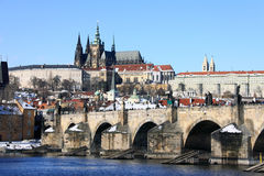 Snowy Prague Gothic Castle With Charles Bridge Royalty Free Stock Image