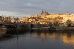 Snowy Prague Lesser Town with gothic Castle above River Vltava, Czech republic Royalty Free Stock Photography