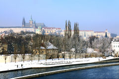 Snowy Prague's gothic Castle above River Vltava Stock Photos
