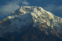 Snowy precipices of southern Annapurna. Trekking to Annapurna Ba. Se Camp, Nepal royalty free stock image