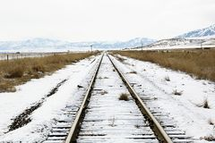 Snowy Railroad Tracks. Snow-covered tracks and mountains stock photo
