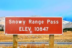Snowy Range Pass Altitude Sign Wyoming. Sign highlighting the high altitude of Snowy Range Pass in the Medicine Bow National Forest of Wyoming royalty free stock photography