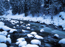 Snowy river. Deep fresh snow covers rocks in white water river stock images