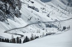 Snowy road. Mountain road in the middle of the snowy slopes stock image