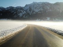 Snowy Road. A beautiful snowy road leading to the mountains in Germany stock photography