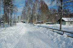 Snowy road. Snow covered road in county part of Sweden stock photography