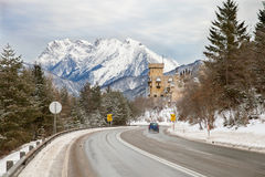 The snowy road in austrian Alps Royalty Free Stock Images
