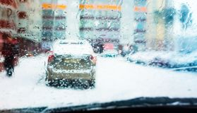 Snowy road, blurred background, snow and water on the car window. Snowy road, blurred background, snow and water on the car stock photos