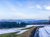 Snowy road in a countryside landscape viewing on the mountains beautiful shot in Germany hochsauerland. A snowy road in a countryside landscape viewing on the stock photography