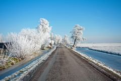 Snowy road in the countryside from the Netherlands. In winter Royalty Free Stock Image