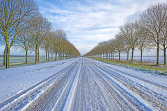 Snowy road through the countryside Royalty Free Stock Images